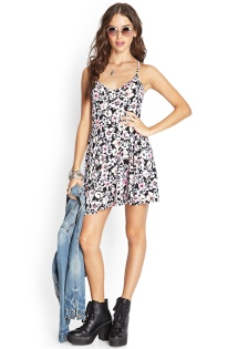 This short floral dress goes great with a denim shirt or a denim vest.