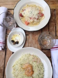 Our food. I ordered the lemon risotto and she ordered linguine with white sauce. The food was delicious and flavorful.