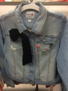 The black velvet bow is detachable and the pins are darling on this denim jacket.