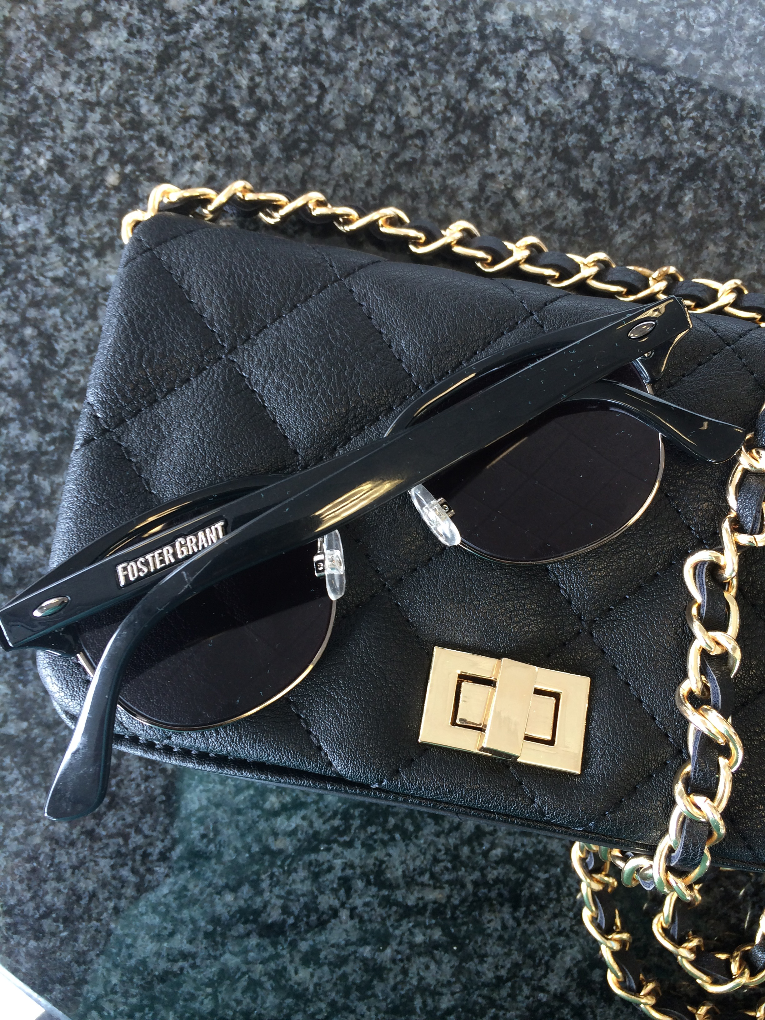 c49a19c8e46 The black quilted bag from Forever 21 along with my favorite Foster Grant  sunglasses